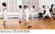 Young fencers training with coach. Стоковое фото, фотограф Яков Филимонов / Фотобанк Лори