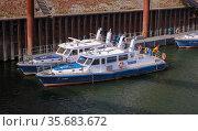 Police boats, Duisburger Hafen AG, Duisport, Ruhr area, North Rhine-Westphalia, Germany, Europe. Редакционное фото, агентство Caro Photoagency / Фотобанк Лори