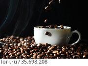 Cup with coffee beans. Стоковое фото, фотограф Иван Михайлов / Фотобанк Лори