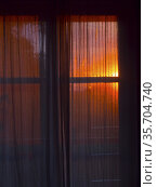 Window with a curtain during sunset. Стоковое фото, фотограф Piotr Ciesla / age Fotostock / Фотобанк Лори