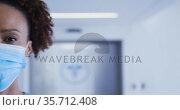 Portrait of mixed race female doctor wearing face mask. Стоковое видео, агентство Wavebreak Media / Фотобанк Лори