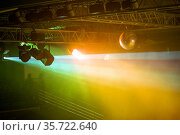 Stage lights. Soffits. Concert light. Silver mirror disco ball in the rays of the spotlights. Стоковое фото, фотограф Евгений Ткачёв / Фотобанк Лори
