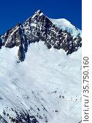 The mighty Aletschhorn in the Bernese Alps in Switzerland. In the... Стоковое фото, фотограф Neil Harrison / age Fotostock / Фотобанк Лори