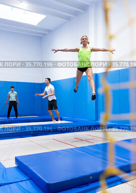 Woman jumping in trampoline center
