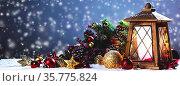 Burning candles , lantern and christmas decoration on snowfall background... Стоковое фото, фотограф Zoonar.com/Ivan Mikhaylov / easy Fotostock / Фотобанк Лори