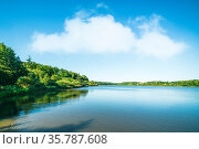 Lake scenery with green trees and blue sky. Стоковое фото, фотограф Zoonar.com/Polarpx / age Fotostock / Фотобанк Лори