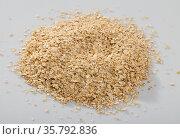 Handful of dry oatmeal on white background, nobody. Стоковое фото, фотограф Яков Филимонов / Фотобанк Лори