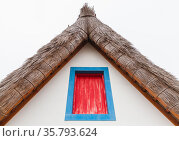 Closed red attic window in blue frame. Madeira (2017 год). Стоковое фото, фотограф EugeneSergeev / Фотобанк Лори