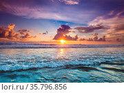 Radiant colorful sea beach sunset on Bali, Indonesia. Стоковое фото, фотограф Zoonar.com/Ivan Mikhaylov / easy Fotostock / Фотобанк Лори