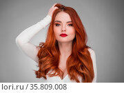 Portrait of young woman with long beautiful ginger hair. Стоковое фото, фотограф Zoonar.com/Ivan Mikhaylov / easy Fotostock / Фотобанк Лори