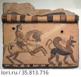 Tile decorated with a rider pursuing a griffin (2014 год). Редакционное фото, агентство World History Archive / Фотобанк Лори