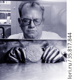 Photograph of a worker handling Plutonium. Редакционное фото, агентство World History Archive / Фотобанк Лори