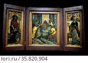 Triptych with the Last Supper and Donors circle of Jacob Cornelisz van Oostsanen, alias Jacob War van Amsterdam (c. 1472/77 - in or before 1533). Редакционное фото, агентство World History Archive / Фотобанк Лори