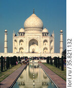 The Taj Mahal is a white marble mausoleum located in Agra, Uttar Pradesh, India. It was built in 1665 by Mughal emperor Shah Jahan in memory of his third wife, Mumtaz Mahal. Редакционное фото, агентство World History Archive / Фотобанк Лори