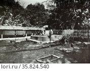 Indonesian man at the sacred tombs. Редакционное фото, агентство World History Archive / Фотобанк Лори