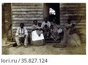 Family of slaves at the Gaines' house. Published 1861 or 1862. African American slave family or families posed in front of wooden house, Washington, D.C. or Hampton, Virginia. Редакционное фото, агентство World History Archive / Фотобанк Лори