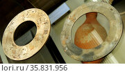 Two jade discs, bi Shang dynasty, 12th-11th century BC. Редакционное фото, агентство World History Archive / Фотобанк Лори