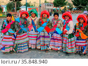 Boys in traditional costumes standing at the main square in Yanque... Стоковое фото, фотограф Zoonar.com/Don Mammoser / age Fotostock / Фотобанк Лори