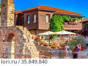Nessebar, Bulgaria - July 25, 2016: Old ruins and wooden houses on... Стоковое фото, фотограф Zoonar.com/Nataliya_Nazarova{} / age Fotostock / Фотобанк Лори