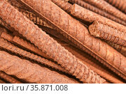 Rusty reinforcing bars piled in a heap close-up. Стоковое фото, фотограф Евгений Харитонов / Фотобанк Лори