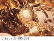 close up of golden brooch. Стоковое фото, агентство Ingram Publishing / Фотобанк Лори