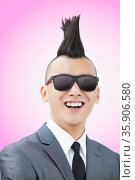 Well-dressed young man with Mohawk and sunglasses smiling. Стоковое фото, агентство Ingram Publishing / Фотобанк Лори