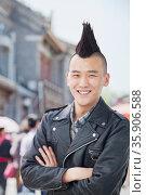 Young man with punk Mohawk portrait. Стоковое фото, агентство Ingram Publishing / Фотобанк Лори