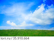 Lush, green landscape with blue sky and clouds. Стоковое фото, агентство Ingram Publishing / Фотобанк Лори