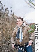 One woman cycling. Стоковое фото, фотограф Shannon Fagan / Ingram Publishing / Фотобанк Лори