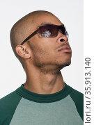 Portrait of young adult African American man. Стоковое фото, фотограф Shannon Fagan / Ingram Publishing / Фотобанк Лори