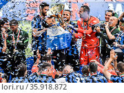 Inter's players celebrate with the Serie A trophy during the awarding... Редакционное фото, фотограф Nicola Marfisi / AGF/Nicola Marfisi / AGF / age Fotostock / Фотобанк Лори