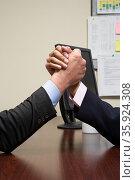 Businessmen arm wrestling. Стоковое фото, фотограф Shannon Fagan / Ingram Publishing / Фотобанк Лори