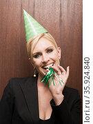 Businesswoman blowing party horn blower. Стоковое фото, фотограф Shannon Fagan / Ingram Publishing / Фотобанк Лори