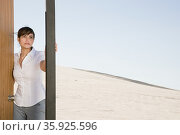 Woman opening door in desert. Стоковое фото, фотограф Shannon Fagan / Ingram Publishing / Фотобанк Лори