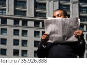 Businessman looking over newspaper. Стоковое фото, фотограф Shannon Fagan / Ingram Publishing / Фотобанк Лори
