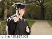 Male graduate. Стоковое фото, фотограф Shannon Fagan / Ingram Publishing / Фотобанк Лори