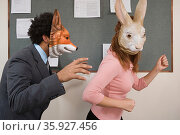 Office workers fooling around in masks. Стоковое фото, фотограф Shannon Fagan / Ingram Publishing / Фотобанк Лори