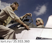 Colour transparency of Ensign Noressey and Cadet Thenis at the Naval Air Base at Corpus Christi, Texas by photographer Howard R. Hollem. Редакционное фото, агентство World History Archive / Фотобанк Лори