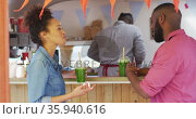 African american couple smiling while drinking smoothies at the food truck. Стоковое видео, агентство Wavebreak Media / Фотобанк Лори
