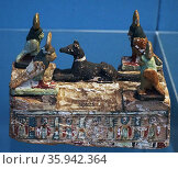 Miniature sarcophagus of painted wood, with ba birds and jackal. Редакционное фото, агентство World History Archive / Фотобанк Лори
