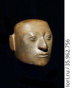 Andean Pre-Hispanic native wooden funerary mask. Редакционное фото, агентство World History Archive / Фотобанк Лори