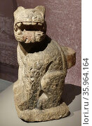 Mayan stone door post in the form of a seated jaguar; from Chichen Itza. Редакционное фото, агентство World History Archive / Фотобанк Лори