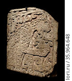 Mayan, calcified stone panel, with bas relief depicting a jaguar eating a heart. Редакционное фото, агентство World History Archive / Фотобанк Лори