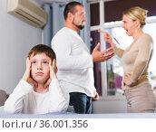 Sad boy during parents quarrel. Стоковое фото, фотограф Яков Филимонов / Фотобанк Лори