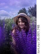 Beautiful woman with lupin flowers in summer field. Стоковое фото, фотограф ElenArt / Фотобанк Лори