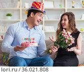 Young couple celebrating birthday with cake. Стоковое фото, фотограф Elnur / Фотобанк Лори