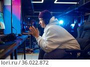 Young gamer resting in gaming armchair, game club. Стоковое фото, фотограф Tryapitsyn Sergiy / Фотобанк Лори