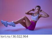 Sportswoman on training in studio, neon background. Стоковое фото, фотограф Tryapitsyn Sergiy / Фотобанк Лори