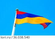 National flag of Armenia waving in the wind against the blue sky. Стоковое фото, фотограф Zoonar.com/Alexander Blinov / easy Fotostock / Фотобанк Лори