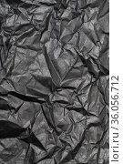 Black color background from sheet of crumpled carton, abstract texture wrinkled cardboard material pattern background. Стоковое фото, фотограф А. А. Пирагис / Фотобанк Лори